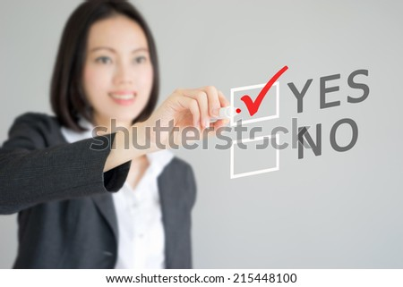 Business woman drawing graph showing profit growth on virtual screen. Asian businesswoman isolated on white background in suit. - stock photo