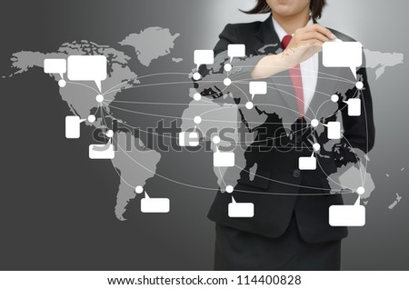 Business woman drawing wold map with cloud computing and social network concept - stock photo