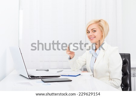 business woman drink coffee at office modern desk, smile businesswoman break relax workplace day - stock photo