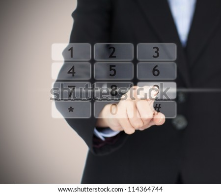 Business woman entering code on projected digital number pad - stock photo
