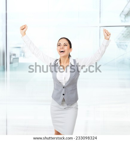 Business woman excited hold hands up raised arms, surprised happy smile business woman isolated over white background, concept winner success in modern office