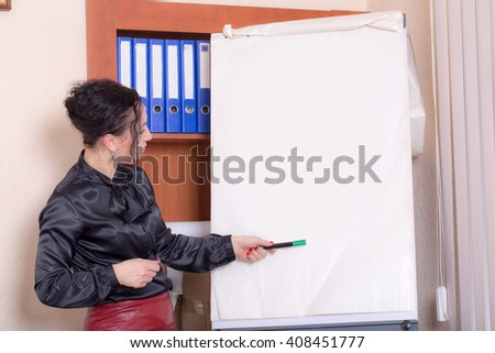 Business woman explaining at the whiteboard. Photo can be used as a whole background.