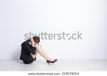 business woman feel unhappy with white wall background, great for your design or text, asian - stock photo