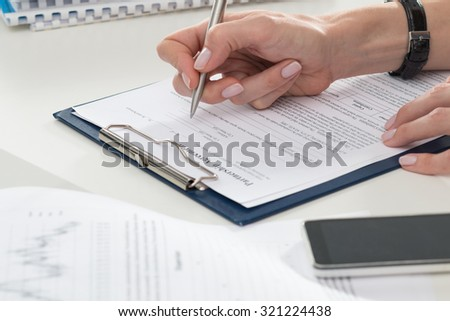 Business woman filling partnership agreement blank. Business and partnership concept - stock photo