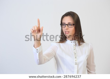 business woman finger pointing at the side.