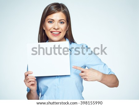 Business woman finger pointing on white sign board. Smiling young woman. - stock photo