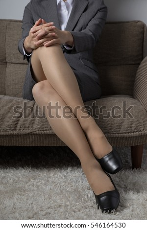 Business woman, foot, tired, swelling, shoes
