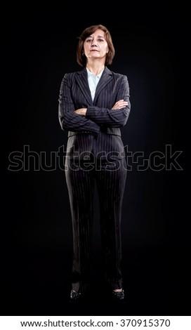 Business woman full length portrait, hands folded. - stock photo