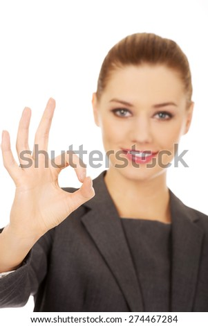 Business woman gesturing perfect sign with hand. - stock photo