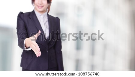 Business woman gives a handshake with smile face at office, model is a asian beauty - stock photo