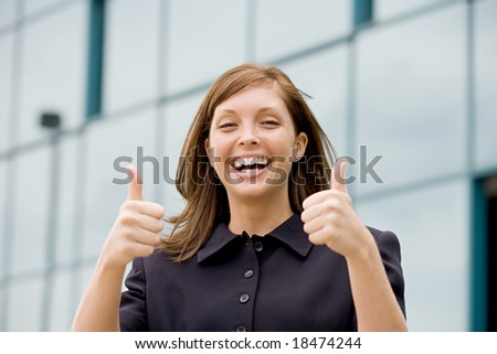 Business Woman Giving a Thumbs Up - stock photo