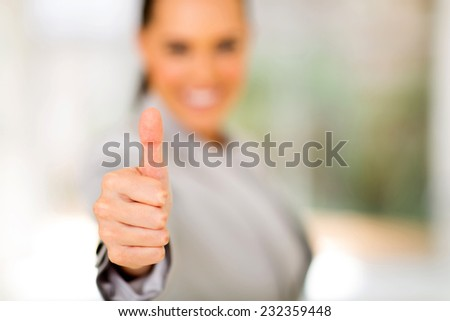 business woman giving thumb up - stock photo