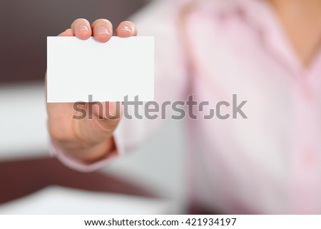 Business woman giving visit card