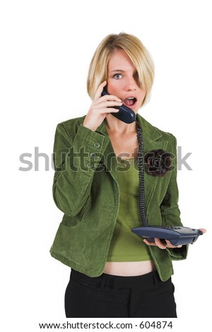 Business woman green jacket, talking on the phone