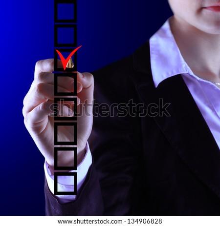 business woman hand choose check mark on box - stock photo