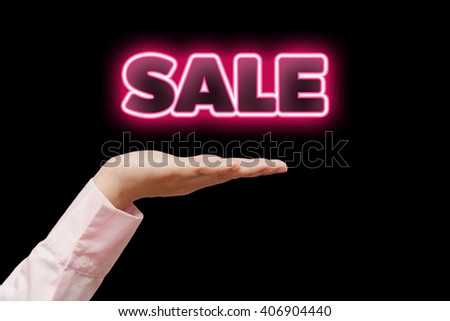 Business woman hand cupped holding the word SALE with red pink neon light - stock photo