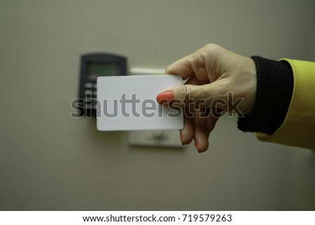 Business woman hand holding Access card / Key Card electronic door accessing control scanning to lock and unlock door. Security scan door open / close Automatic Technology system concept