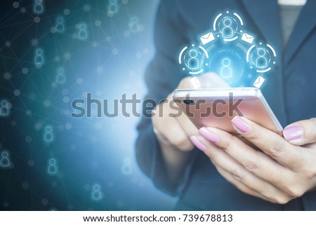 business woman hand holding smart phone with email and social connection icon, technology with people concept background