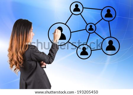 Business woman hand pressing social network icon on blue background - stock photo