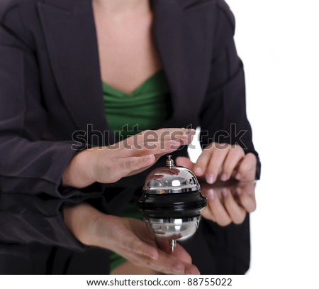 business woman hand pushing bell; business concept
