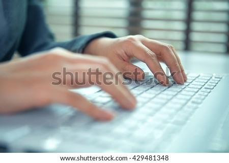 business woman hand typing on laptop keyboard