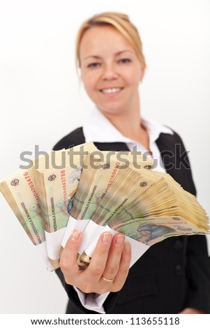Business woman handing you stacks of romanian currency - shallow depth, focus on money - stock photo