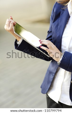 Business woman hands holding a tablet computer - stock photo