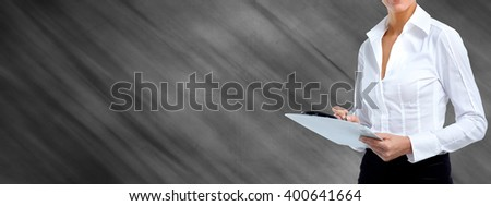 Business woman hands with a clipboard. - stock photo