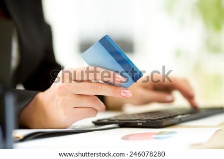 Business woman hands with credit card typing on keyboard for online payment