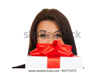 Business woman happy eyes behind red bow gift box.  close up, isolated over white background. - stock photo