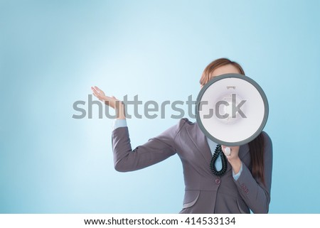 Business woman happy with a megaphone isolated on blue background, model is a asian beauty