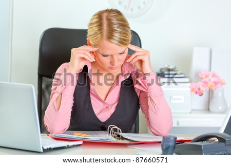 Business woman hard working on document at workplace - stock photo
