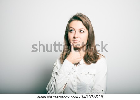 Business woman has a good idea. office manager. studio photo on a gray background