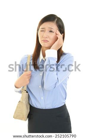 Business woman having a headache - stock photo