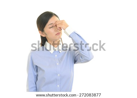Business woman having a headache