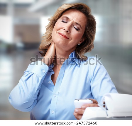 Business woman having a neck pain. Stress and depression - stock photo