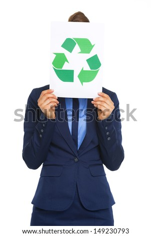 Business woman hiding behind recycle sign