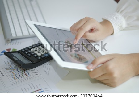 business woman hold analyzing financial chart on tablet , strategy concept