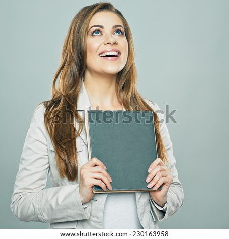 business woman hold book , looking up. isolated studio background. - stock photo