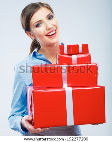 Business woman hold gift box in christmas color style, studio portrait. Young female model. - stock photo