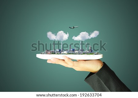 Business woman hold touch pad or tablet with Oil refinery Plant, airplane and cloud - stock photo