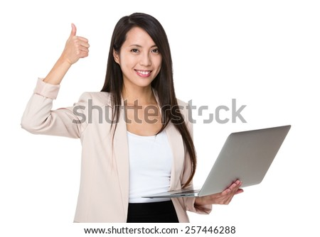 Business woman hold with laptop and thumb up - stock photo