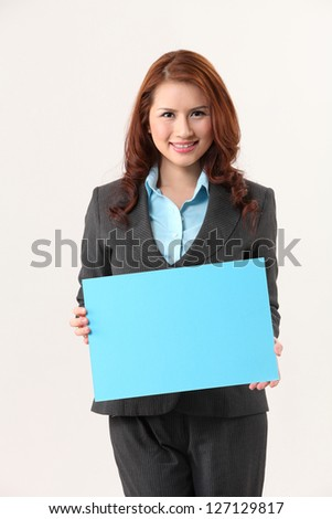 business woman holding a blank blue cardboard