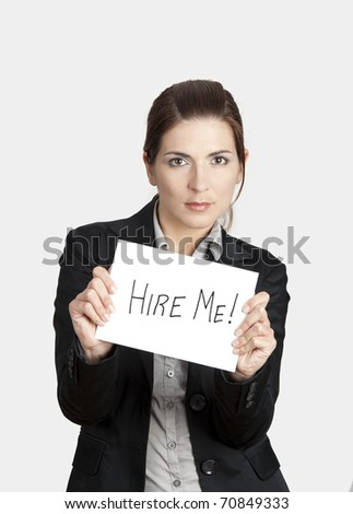 "Business woman holding a card board with the text message ""Hire me""."