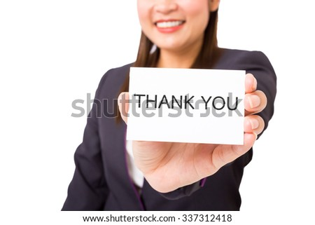 "Business woman holding a card with the words ""THANK YOU"". - stock photo"