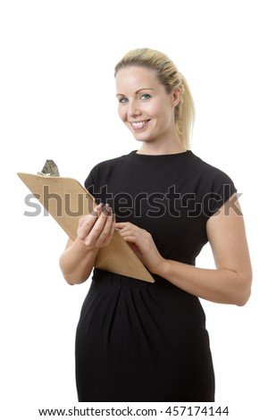 business woman holding a clip board and pen