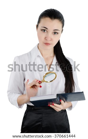 Business woman holding a magnifying glass and a book. White isolated background - stock photo