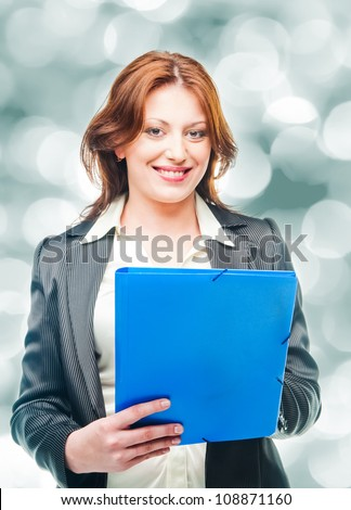 business woman holding a portfolio - stock photo