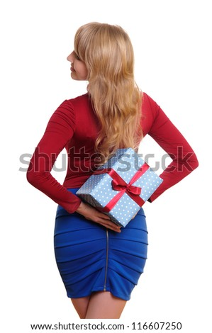 business woman holding a present on her back