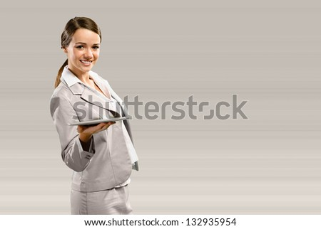Business woman holding a touchpad, place for text - stock photo